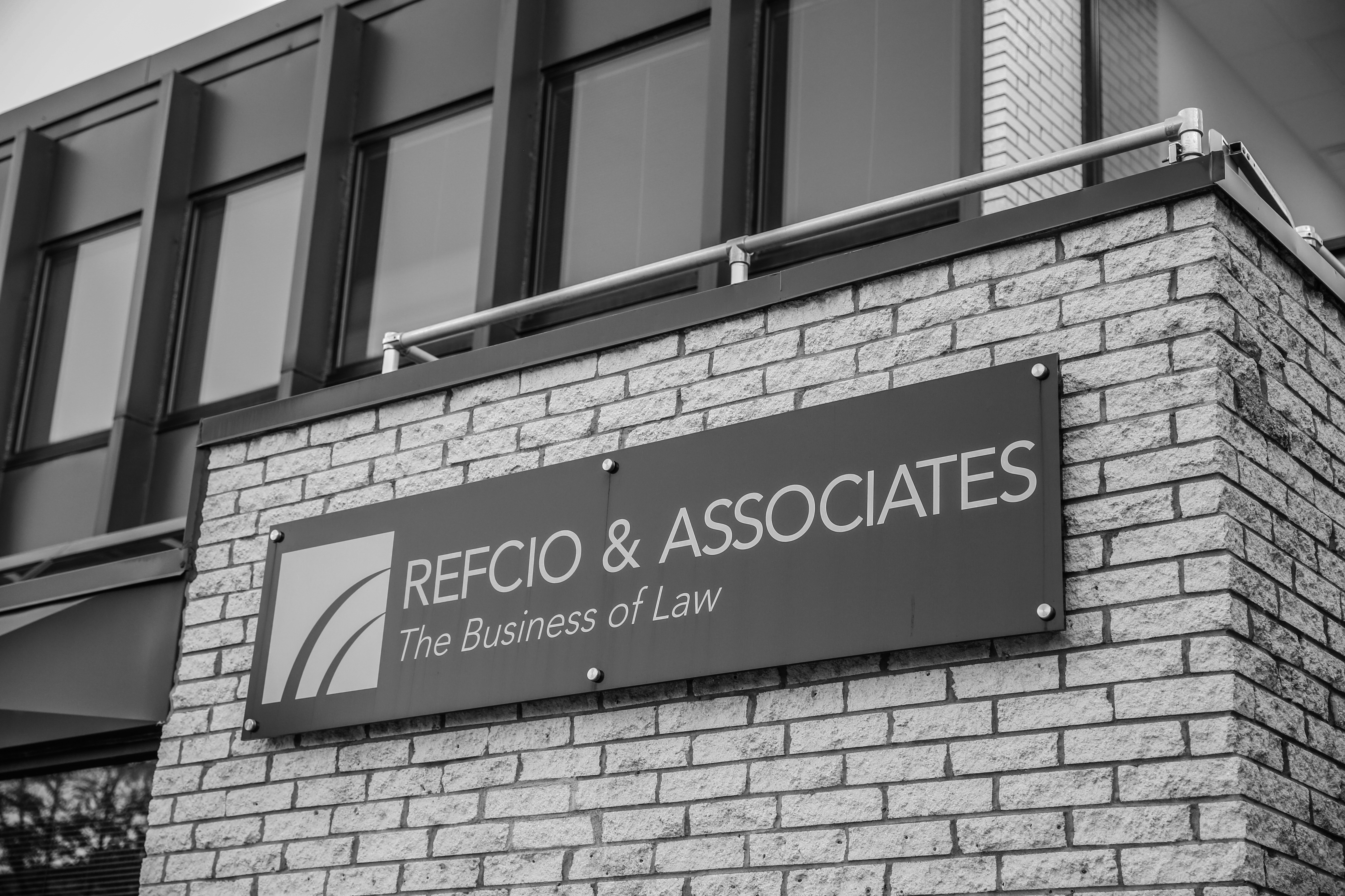 Refcio London's Office Sign for flat rate fee lawyers